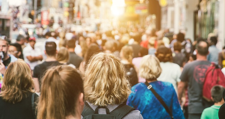 64590902 - unrecognizable mass of people walking in the city